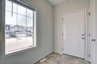 Photo 4: 311 TARALAKE Terrace NE in Calgary: Taradale Detached for sale : MLS®# A1128054