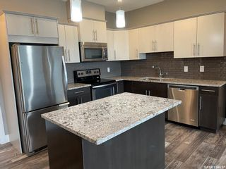 Photo 2: 220 415 Maningas Bend in Saskatoon: Evergreen Residential for sale : MLS®# SK869791