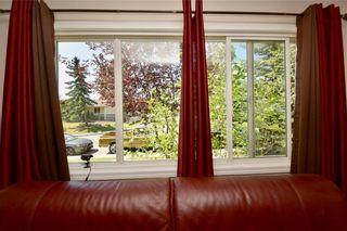 Photo 4: 816 MADEIRA Drive NE in Calgary: Marlborough Park Row/Townhouse for sale : MLS®# C4262604