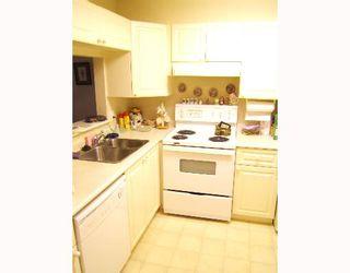 "Photo 5: 202 2405 KAMLOOPS Street in Vancouver: Renfrew VE Condo for sale in ""8TH AVENUE TERRACE"" (Vancouver East)  : MLS®# V651808"