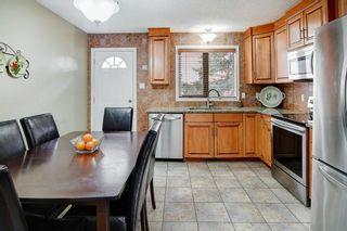 Photo 9: 416 HUNTBOURNE Hill NE in Calgary: Huntington Hills Detached for sale : MLS®# C4299383