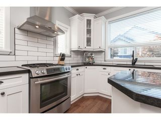 """Photo 13: 7089 179 Street in Surrey: Cloverdale BC House for sale in """"Provinceton"""" (Cloverdale)  : MLS®# R2492815"""