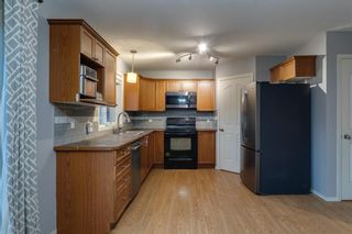 Photo 6: 704 Luxstone Square SW: Airdrie Detached for sale : MLS®# A1133096