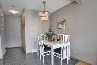 Photo 6: 104 Millview Green SW in Calgary: Millrise Row/Townhouse for sale : MLS®# A1120557