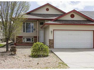 Photo 1: 11 WESTFALL Crescent in : Okotoks Residential Detached Single Family for sale : MLS®# C3619758