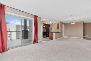 Photo 11: 7411 403 Mackenzie Way SW: Airdrie Apartment for sale : MLS®# A1152134