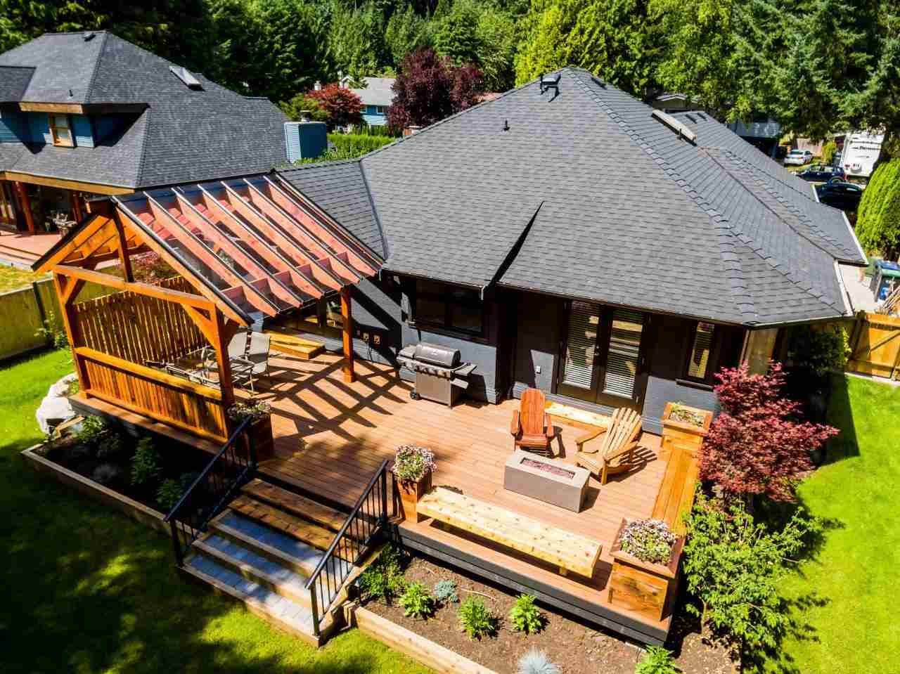 Patio with covered Pergola, gas hook up firetable is accessed of family room and master