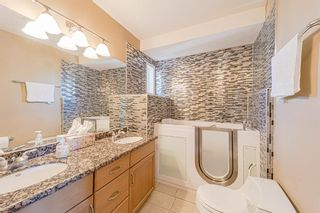 Photo 32: 415 52 Avenue SW in Calgary: Windsor Park Semi Detached for sale : MLS®# A1112515