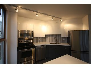 Photo 2: 305 1633 W 8TH Avenue in Vancouver: Fairview VW Condo for sale (Vancouver West)  : MLS®# V1056402