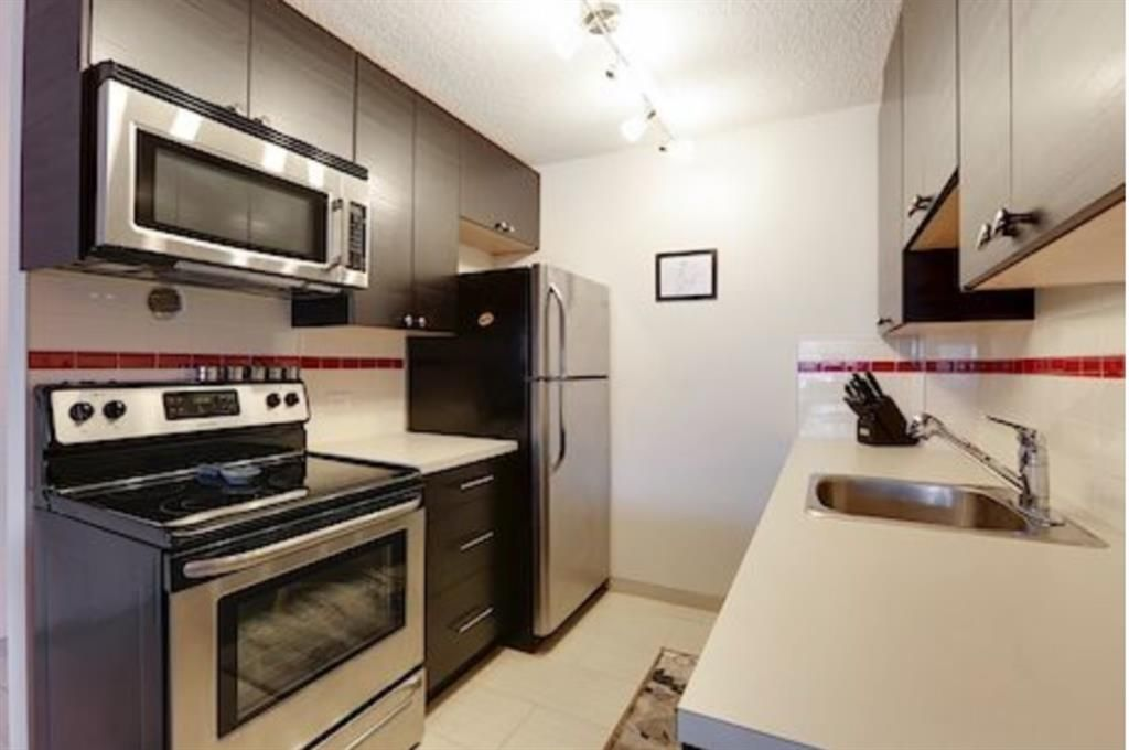 Main Photo: 510 519 17 Avenue SW in Calgary: Cliff Bungalow Apartment for sale : MLS®# A1092264