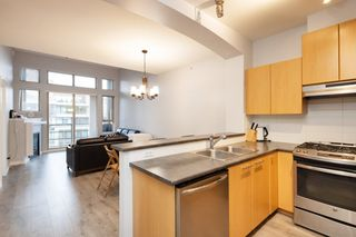 "Photo 2: 411 9339 UNIVERSITY Crescent in Burnaby: Simon Fraser Univer. Condo for sale in ""HARMONY AT THE HIGHLANDS"" (Burnaby North)  : MLS®# R2544462"