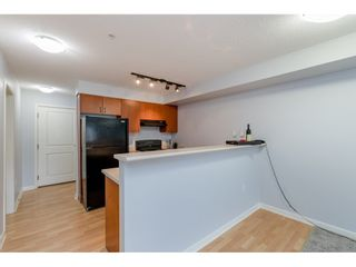 """Photo 3: 209 5465 203 Street in Langley: Langley City Condo for sale in """"Station 54"""" : MLS®# R2394003"""