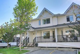 Photo 1: 403 950 Arbour Lake Road NW in Calgary: Arbour Lake Row/Townhouse for sale : MLS®# A1140525