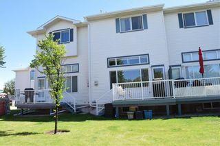 Photo 39: 105 Rocky Ridge Court NW in Calgary: Rocky Ridge Row/Townhouse for sale : MLS®# A1069587