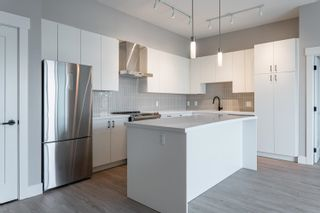 """Photo 7: A605 20838 78B Avenue in Langley: Willoughby Heights Condo for sale in """"Hudson & Singer"""" : MLS®# R2608536"""