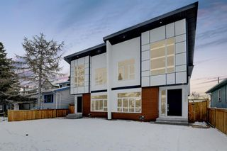 Photo 1: 835 21 Avenue NW in Calgary: Mount Pleasant Semi Detached for sale : MLS®# A1056279