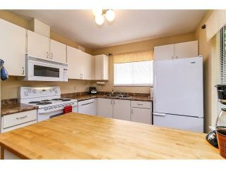 "Photo 9: 6929 135TH Street in Surrey: West Newton 1/2 Duplex for sale in ""Bentley"" : MLS®# F1432767"
