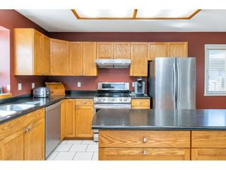 """Photo 12: 4553 217 Street in Langley: Murrayville House for sale in """"Murrayville"""" : MLS®# R2569555"""
