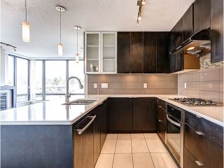 Photo 2: 601 7328 ARCOLA STREET - LISTED BY SUTTON CENTRE REALTY in Burnaby: Highgate Condo for sale (Burnaby South)  : MLS®# R2039813