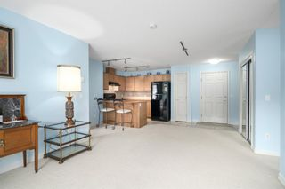 Photo 8: 3215 92 Crystal Shores Road: Okotoks Apartment for sale : MLS®# A1103721