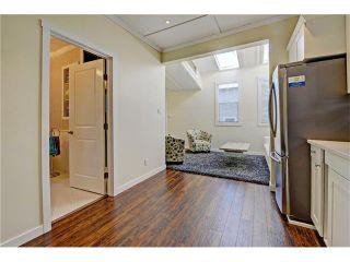 Photo 8: 309 28 AV NE in Calgary: Tuxedo Park House for sale : MLS®# C4066138