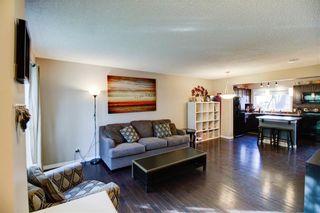 Photo 2: 104 AUBURN BAY Street SE in Calgary: Auburn Bay Semi Detached for sale : MLS®# C4254127