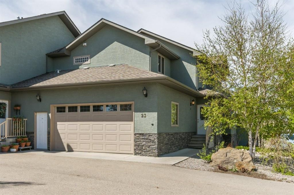 Main Photo: 23 6 Avenue SE: High River Row/Townhouse for sale : MLS®# A1112203
