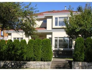 Photo 1: 1521 W 61ST AV in Vancouver West: Home for sale : MLS®# V608796