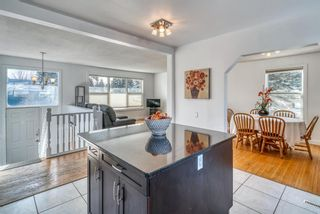 Photo 5: 10011 Warren Road SE in Calgary: Willow Park Detached for sale : MLS®# A1083323