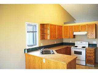 Photo 5: 110 RIVERSIDE Crescent NW: High River Residential Attached for sale : MLS®# C3586695