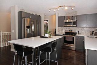 Photo 2: 150 SIERRA MORENA Green SW in Calgary: Signal Hill Semi Detached for sale : MLS®# C4294860