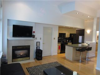 """Photo 1: 100 1788 W 13TH Avenue in Vancouver: Fairview VW Condo for sale in """"MAGNOLIA"""" (Vancouver West)  : MLS®# V985193"""