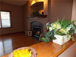 Photo 3: 120 SUNSET Close: Cochrane House for sale : MLS®# C4038629