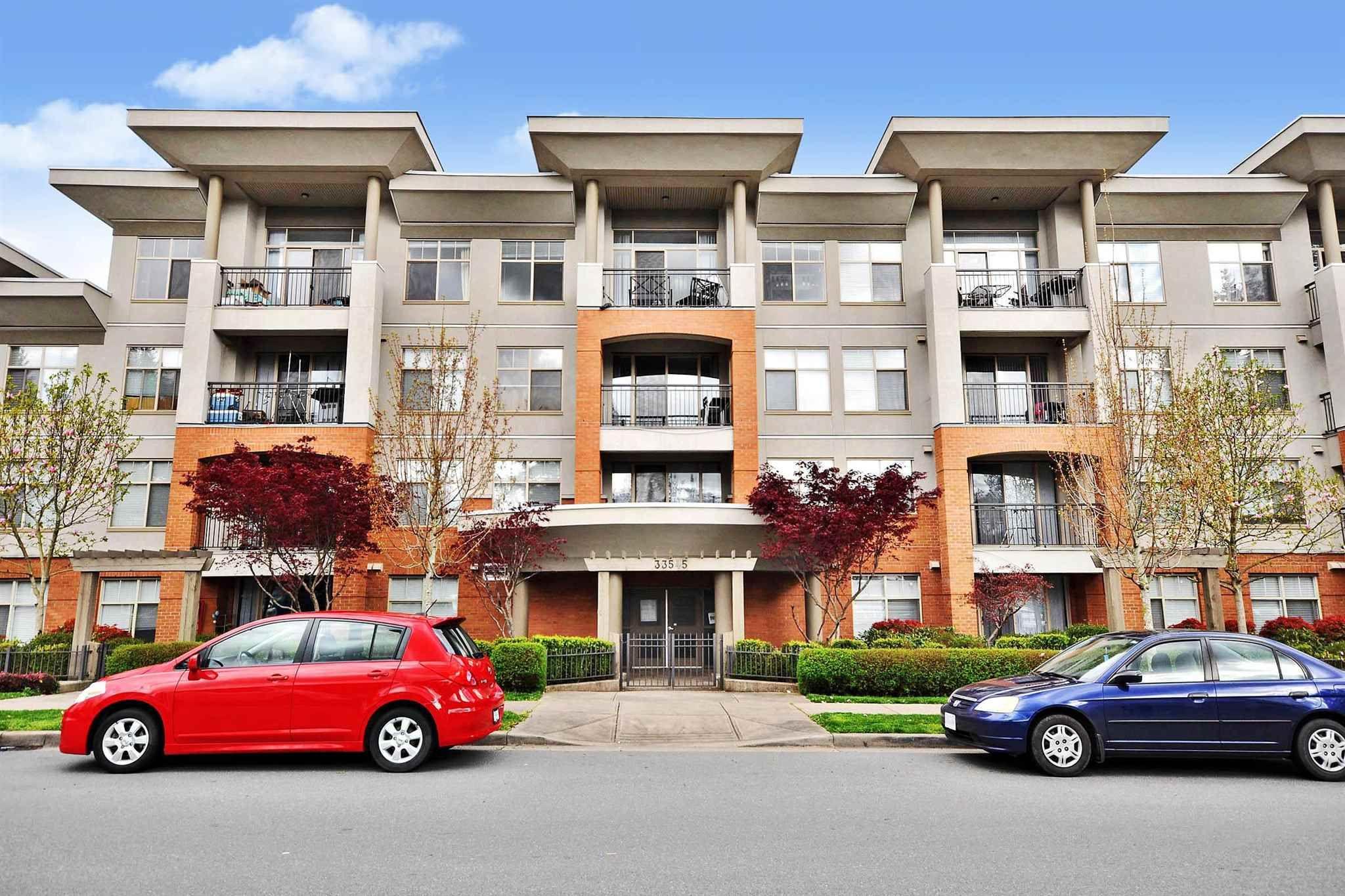 """Main Photo: 204 33545 RAINBOW Avenue in Abbotsford: Central Abbotsford Condo for sale in """"Tempo"""" : MLS®# R2606221"""