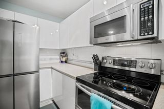 """Photo 20: 407 8420 JELLICOE Street in Vancouver: South Marine Condo for sale in """"THE BOARDWALK"""" (Vancouver East)  : MLS®# R2618056"""