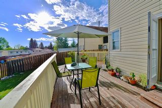 Photo 7: 8207 Ranchview Drive NW in Calgary: Ranchlands Detached for sale : MLS®# A1115978