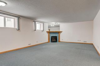 Photo 23: 25 Strathearn Gardens SW in Calgary: Strathcona Park Semi Detached for sale : MLS®# A1045110