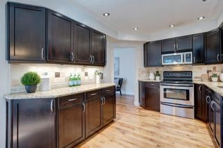 Photo 7: 212 Coachway Lane SW in Calgary: Coach Hill Row/Townhouse for sale : MLS®# A1153091