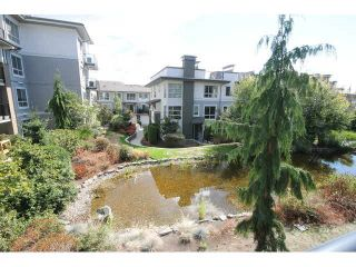 Photo 1: 207 6688 120 STREET in Surrey: West Newton Condo for sale : MLS®# R2073827