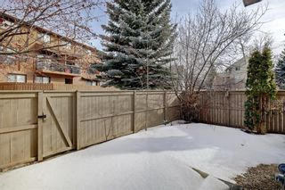Photo 4: 14 Glamis Gardens SW in Calgary: Glamorgan Row/Townhouse for sale : MLS®# A1076786