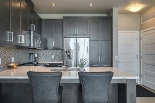 Photo 22: 408 145 Burma Star Road SW in Calgary: Currie Barracks Apartment for sale : MLS®# A1120327