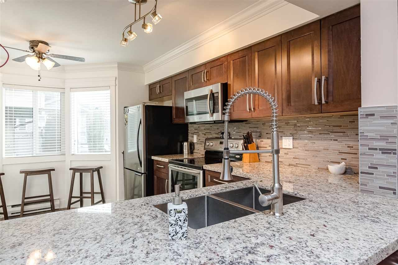 """Main Photo: 12 7549 140 Street in Surrey: East Newton Townhouse for sale in """"Glenview Estates"""" : MLS®# R2424248"""