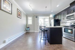 """Photo 16: 77 6383 140 Street in Surrey: Sullivan Station Townhouse for sale in """"PANORAMA WEST VILLAGE"""" : MLS®# R2573308"""