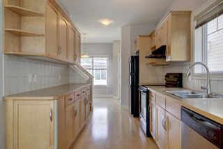 Photo 8: 76 Bridleridge Manor SW in Calgary: Bridlewood Row/Townhouse for sale : MLS®# A1106883