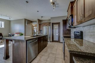 Photo 6: 26 BRIGHTONWOODS Bay SE in Calgary: New Brighton Detached for sale : MLS®# A1110362