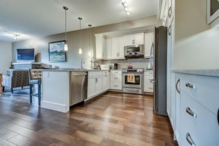 Photo 10: 101 830 2 Avenue NW in Calgary: Sunnyside Row/Townhouse for sale : MLS®# A1150753