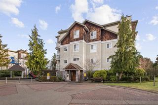 """Photo 1: 208 10186 155 Street in Surrey: Guildford Condo for sale in """"SOMMERSET"""" (North Surrey)  : MLS®# R2528619"""