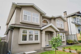 Photo 1: 7871 CUMBERLAND Street in Burnaby: East Burnaby House for sale (Burnaby East)  : MLS®# R2413062