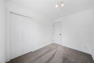 Photo 23: 316 Queen Alexandra Road SE in Calgary: Queensland Detached for sale : MLS®# A1142410