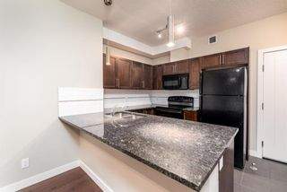Photo 5: 2129 604 East Lake Boulevard NE: Airdrie Apartment for sale : MLS®# A1106978